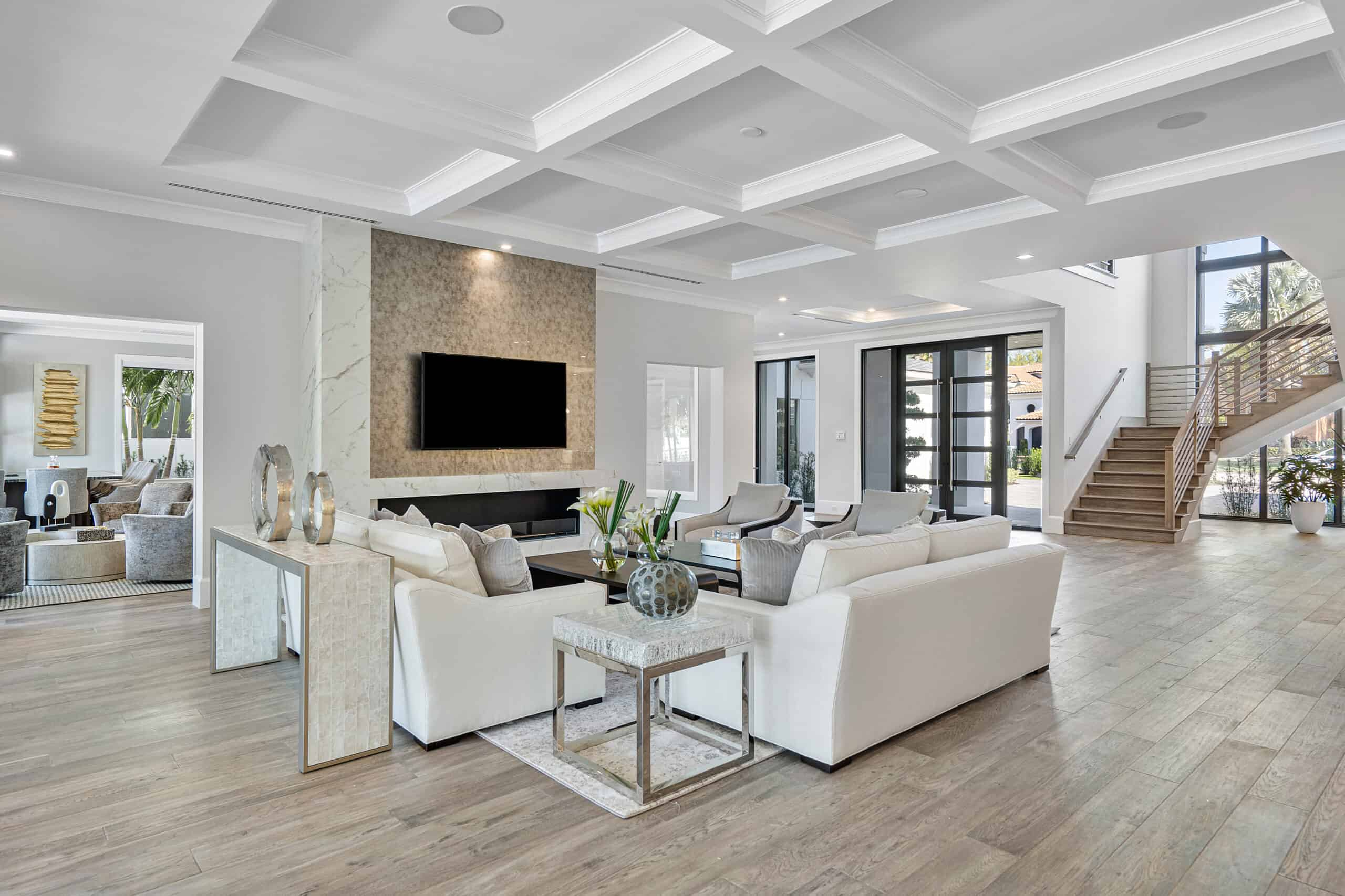 Modern great room design by Interiors by Brown